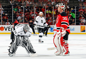 NEWARK, NJ - JUNE 09: Jonathan Quick #32 of the Los Angeles Kings and Martin Brodeur #30 of the New Jersey Devils look on during a stoppage in play during Game Five of the 2012 NHL Stanley Cup Final at the Prudential Center on June 9, 2012 in Newark, New