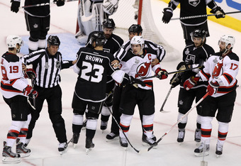 LOS ANGELES, CA - JUNE 04:  NHL linesman Jonny Murray #95 separates Travis Zajac #19 of the New Jersey Devils and Dustin Brown #23 of the Los Angeles Kings as Zach Parise #9, Ilya Kovalchuk #17 of the New Jersey Devils and Slava Voynov #26 of the Los Ange