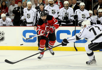 NEWARK, NJ - JUNE 02:  Ilya Kovalchuk #17 of the New Jersey Devils fires the puck against Jeff Carter #77 of the Los Angeles Kings during Game Two of the 2012 NHL Stanley Cup Final at the Prudential Center on June 2, 2012 in Newark, New Jersey.  (Photo by