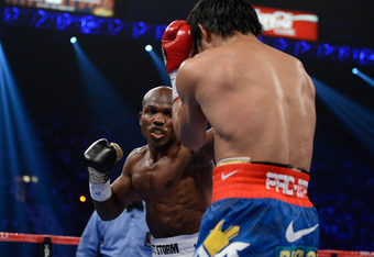 LAS VEGAS, NV - JUNE 09:  (L-R) Timothy Bradley lands a left to the head of Manny Pacquiao during their WBO welterweight title fight at MGM Grand Garden Arena on June 9, 2012 in Las Vegas, Nevada.  (Photo by Kevork Djansezian/Getty Images)