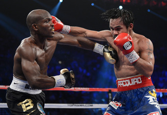 LAS VEGAS, NV - JUNE 09:  (L-R) Timothy Bradley and Manny Pacquiao exchange punches during their WBO welterweight title fight at MGM Grand Garden Arena on June 9, 2012 in Las Vegas, Nevada.  (Photo by Kevork Djansezian/Getty Images)