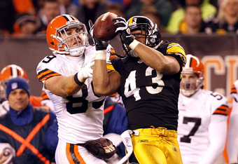 CLEVELAND, OH - JANUARY 01: Safety Troy Polamalu #43 of the Pittsburgh Steelers catches an interception in front of tight end Evan Moore #89 of the Cleveland Browns at Cleveland Browns Stadium on January 1, 2012 in Cleveland, Ohio. (Photo by Matt Sullivan