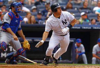 NEW YORK, NY - JUNE 10:  Mark Teixeira #25 of the New York Yankees hits a single and drives in a run  during their game against the New York Mets on June10, 2012 at Yankee Stadium in the Bronx borough of New York City.  (Photo by Al Bello/Getty Images)