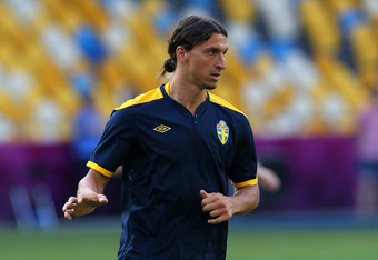 KIEV, UKRAINE - JUNE 10:  Zlatan Ibrahimovic of Sweden runs with the ball during a UEFA EURO 2012 training session at the Olympic Stadium on June 10, 2012 in Kiev, Ukraine.  (Photo by Alex Livesey/Getty Images)
