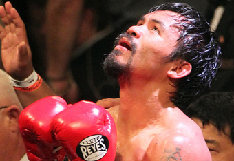 Manny Pacquiao's 15-fight win streak came to an end in controversial fashion. (From Getty via BadLeftHook.com)