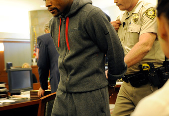 LAS VEGAS, NV - JUNE 01: Boxer Floyd Maywether Jr. is lead away in handcuffs at the Clark County Regional Justice Center as he surrenders to serve a three-month jail sentence at theÊClark County Detention CenterÊon June 1, 2012 in Las Vegas, Nevada. ÊMayw