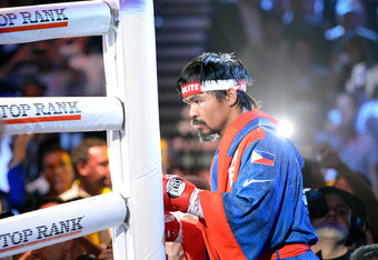 LAS VEGAS, NV - JUNE 09:  Manny Pacquiao enters the ring before his bout against Timothy Bradley at MGM Grand Garden Arena on June 9, 2012 in Las Vegas, Nevada.  (Photo by Kevork Djansezian/Getty Images)