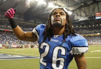 DETROIT - OCTOBER 10: Louis Delmas #26 of the Detroit Lions gets the fans  pumped up prior to the start of the game against the Chicago Bears at Ford Field on October 10, 2011 in Detroit, Michigan.  (Photo by Leon Halip/Getty Images)
