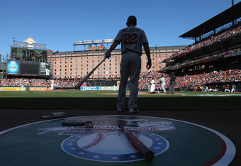 BALTIMORE, MD - APRIL 06: Danny Valencia #22 of the Minnesota Twins waits to bat against the Baltimore Orioles during opening day at Oriole Park at Camden Yards on April 6, 2012 in Baltimore, Maryland.  (Photo by Rob Carr/Getty Images)