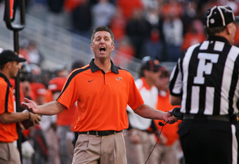 STILLWATER, OK - OCTOBER 29:  Head Coach Mike Gundy of the Oklahoma State Cowboys questions a call in the second half against the Baylor Bears on October 29, 2011 at Boone Pickens Stadium in Stillwater, Oklahoma.  Oklahoma State defeated Baylor 59-24.  (P