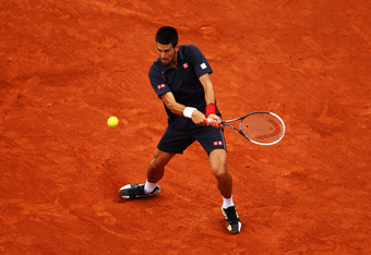 PARIS, FRANCE - JUNE 10:  Novak Djokovic of Serbia plays a backhand during the men's singles final against Rafael Nadal of Spain on day 15 of the French Open at Roland Garros on June 10, 2012 in Paris, France.  (Photo by Clive Brunskill/Getty Images)