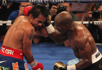 LAS VEGAS, NV - JUNE 09:  (R-L) Timothy Bradley lands a right to the head of Manny Pacquiao during their WBO welterweight title fight at MGM Grand Garden Arena on June 9, 2012 in Las Vegas, Nevada.  (Photo by Jeff Bottari/Getty Images)