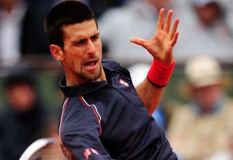 PARIS, FRANCE - JUNE 10:  Novak Djokovic of Serbia plays a forehand during the men's singles final against Rafael Nadal of Spain on day 15 of the French Open at Roland Garros on June 10, 2012 in Paris, France.  (Photo by Mike Hewitt/Getty Images)