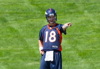 ENGLEWOOD, CO - MAY 21:  Peyton Manning #18 of the Denver Broncos signals during organized team activities at Dove Valley on May 21, 2012 in Englewood, Colorado. (Photo by Justin Edmonds/Getty Images)