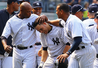 NEW YORK, NY - JUNE 10:  Russell Martin #55 of the New York Yankees celebrates his game winning walk off home run against the New York Mets with Dewayne Wise #45 and Alex Rodriguez #13 defeating them 5-4 on June 10, 2012 at Yankee Stadium in the Bronx bor