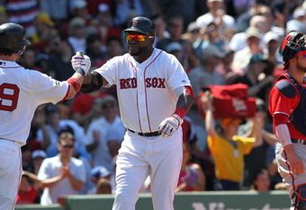 BOSTON, MA - JUNE 10:  David Ortiz #34 of the Boston Red Sox celebrates his home run with Jarrod Saltalamacchia #39 as Jesus Flores #26 of the Washington Nationals looks away during interleague play at Fenway Park June 10, 2012  in Boston, Massachusetts.