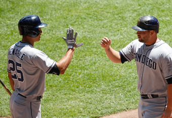 MILWAUKEE, WI - JUNE 10: Yonder Alonso #23 of the San Diego Padres is congratulated by Will Venable #25 after scoring during the game against the Milwaukee Brewers at Miller Park on June 10, 2012 in Milwaukee, Wisconsin. (Photo by Scott Boehm/Getty Images