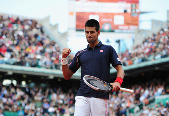 PARIS, FRANCE - JUNE 08:  Novak Djokovic of Serbia celebrates a point in his men's singles semi final match against Roger Federer of Switzerland during day 13 of the French Open at Roland Garros on June 8, 2012 in Paris, France.  (Photo by Mike Hewitt/Get