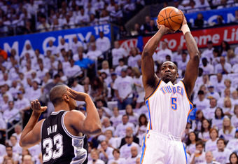 OKLAHOMA CITY, OK - JUNE 06:  Kendrick Perkins #5 of the Oklahoma City Thunder shoots the ball over Boris Diaw #33 of the San Antonio Spurs in Game Six of the Western Conference Finals of the 2012 NBA Playoffs at Chesapeake Energy Arena on June 6, 2012 in