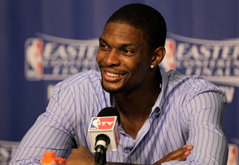 MIAMI, FL - JUNE 09:  Chris Bosh #1 of the Miami Heat speaks with the media after beating the Boston Celtics in Game Seven of the Eastern Conference Finals in the 2012 NBA Playoffs at American Airlines Arena on June 9, 2012 in Miami, Florida.  (Photo by M