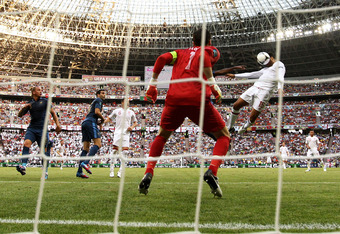 DONETSK, UKRAINE - JUNE 11: Joleon Lescott of England heads the ball past Hugo Lloris of France to score their first goal during the UEFA EURO 2012 group D match between France and England at Donbass Arena on June 11, 2012 in Donetsk, Ukraine.  (Photo by