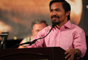 LAS VEGAS, NV - JUNE 09:  Manny Pacquiao addresses the media during the post-fight press conference after he was defeated by Timothy Bradley by split decision at MGM Grand Garden Arena on June 9, 2012 in Las Vegas, Nevada.  (Photo by Jeff Bottari/Getty Im