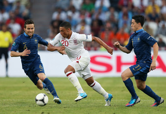 DONETSK, UKRAINE - JUNE 11:  Alex Oxlade-Chamberlain of England is closed down by Yohan Cabaye and Samir Nasri of France during the UEFA EURO 2012 group D match between France and England at Donbass Arena on June 11, 2012 in Donetsk, Ukraine.  (Photo by J