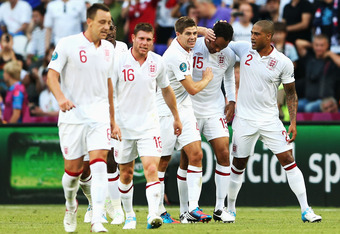 DONETSK, UKRAINE - JUNE 11:   Joleon Lescott of England celebrates scoring with Glen Johnson  and Steven Gerrard of England during the UEFA EURO 2012 group D match between France and England at Donbass Arena on June 11, 2012 in Donetsk, Ukraine.  (Photo b
