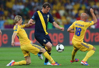 KIEV, UKRAINE - JUNE 11:  Kim Kallstrom of Sweden is closed down by Anatoliy Tymoshchuk  and Serhiy Nazarenko of Ukraine during the UEFA EURO 2012 group D match between Ukraine and Sweden at The Olympic Stadium on June 11, 2012 in Kiev, Ukraine.  (Photo b