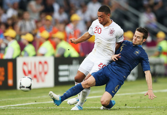 DONETSK, UKRAINE - JUNE 11: Yohan Cabaye of France tackles Alex Oxlade-Chamberlain of England during the UEFA EURO 2012 group D match between France and England at Donbass Arena on June 11, 2012 in Donetsk, Ukraine.  (Photo by Scott Heavey/Getty Images)