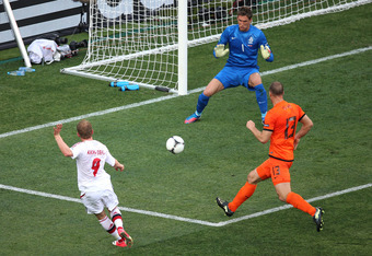 KHARKOV, UKRAINE - JUNE 09:  Michael Krohn-Dehli of Denmark scores their first goal past Maarten Stekelenburg of Netherlands during the UEFA EURO 2012 group B match between Netherlands and Denmark at Metalist Stadium on June 9, 2012 in Kharkov, Ukraine.