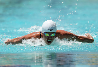 SANTA CLARA, CA - JUNE 01:  Natalie Coughlin competes in the 100 meter women's butterfly during day 2 of the Santa Clara International Grand Prix at George F. Haines International Swim Center on June 1, 2012 in Santa Clara, California.  (Photo by Ezra Sha