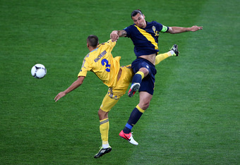 KIEV, UKRAINE - JUNE 11: Zlatan Ibrahimovic of Sweden and Yevhen Khacheridi of Ukraine clash during the UEFA EURO 2012 group D match between Ukraine and Sweden at The Olympic Stadium on June 11, 2012 in Kiev, Ukraine.  (Photo by Martin Rose/Getty Images)