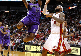 MIAMI, FL - FEBRUARY 21: Tyreke Evans #13 of the Sacramento Kings shoots over LeBron James #6 of the Miami Heat during a game  at American Airlines Arena on February 21, 2012 in Miami, Florida. NOTE TO USER: User expressly acknowledges and agrees that, by