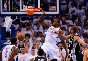 OKLAHOMA CITY, OK - JUNE 06:  Serge Ibaka #9 of the Oklahoma City Thunder  dunks the ball against Tim Duncan #21 of the San Antonio Spurs in Game Six of the Western Conference Finals of the 2012 NBA Playoffs at Chesapeake Energy Arena on June 6, 2012 in O