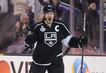 LOS ANGELES, CA - JUNE 11:  Dustin Brown #23 of the Los Angeles Kings reacts after assisting on the Kings' second goal of the first period against the New Jersey Devils in Game Six of the 2012 Stanley Cup Final at Staples Center on June 11, 2012 in Los An