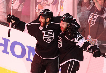 LOS ANGELES, CA - JUNE 11:  Trevor Lewis #22 and Dwight King #74 of the Los Angeles Kings celebrate after Lewis scored the Kings' third goal in the first period of Game Six of the 2012 Stanley Cup Final against the New Jersey Devils at Staples Center on J