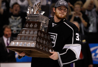 LOS ANGELES, CA - JUNE 11:  Goaltender Jonathan Quick #32 of the Los Angeles Kings holds the Conne Smythe Trophy for the Most Valuable Player in the NHL Playoffs after the Los Angeles Kings defeated the New Jersey Devils 6-1 in Game Six to win the series