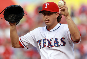 ARLINGTON, TX - APRIL 07:  Derek Holland #45 of the Texas Rangers throws against the Chicago White Sox at Rangers Ballpark in Arlington on April 7, 2012 in Arlington, Texas.  (Photo by Ronald Martinez/Getty Images)