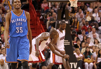 Despite a lack of experience, Durant (left) is ready to take down LeBron James (center on the floor).