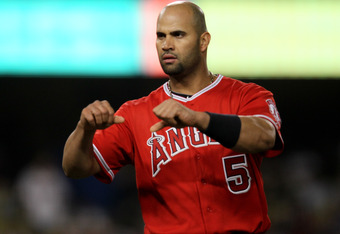 LOS ANGELES, CA - JUNE 11:  Albert Pujols #5 of the Los Angeles Angels of Anaheim celebrates in the middle of the ninth inning after his battin in the go ahead run with a single against the Los Angeles Dodgers on June 11, 2012 at Dodger Stadium in Los Ang