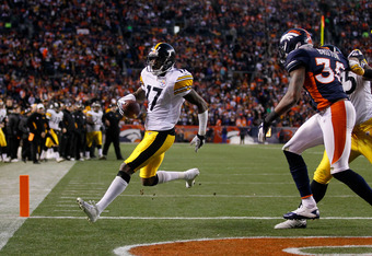 DENVER, CO - JANUARY 08:  Mike Wallace #17 of the Pittsburgh Steelers runs the ball for a touchdown in the third quarter against the Denver Broncos during the AFC Wild Card Playoff game at Sports Authority Field at Mile High on January 8, 2012 in Denver,