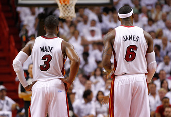 MIAMI, FL - JUNE 05:  (L-R) Dwyane Wade #3 and LeBron James #6 of the Miami Heat stand on court against the Boston Celtics in Game Five of the Eastern Conference Finals in the 2012 NBA Playoffs on June 5, 2012 at American Airlines Arena in Miami, Florida.