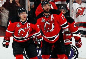 NEWARK, NJ - JUNE 09: Zach Parise #9 of the New Jersey Devils celebrates with Ilya Kovalchuk #17 after Parise scores a goal in the first period against the Los Angeles Kings during Game Five of the 2012 NHL Stanley Cup Final at the Prudential Center on Ju