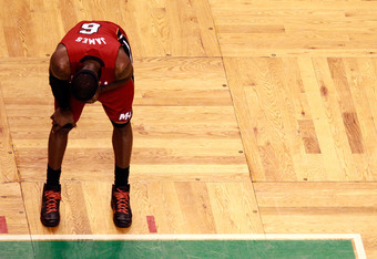 BOSTON, MA - JUNE 07:  LeBron James #6 of the Miami Heat stands on the court with his head down in the first quarter against the Boston Celtics in Game Six of the Eastern Conference Finals in the 2012 NBA Playoffs on June 7, 2012 at TD Garden in Boston, M