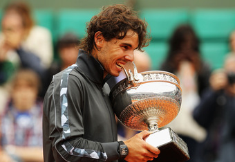 PARIS, FRANCE - JUNE 11:  Rafael Nadal of Spain poses with the Coupe des Mousquetaires trophy in the men's singles final against Novak Djokovic of Serbia during day 16 of the French Open at Roland Garros on June 11, 2012 in Paris, France.  (Photo by Matth