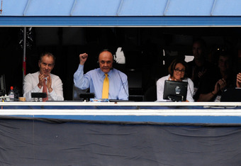 NEW YORK, NY - SEPTEMBER 12:  (L-R) CBS tennis analysts John McEnroe, Dick Enberg and Mary Carillo look on from the announcers booth as they call the match between Rafael Nadal of Spain and  Novak Djokovic of Serbia during the Men's Final on Day Fifteen o