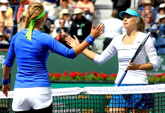 INDIAN WELLS, CA - MARCH 18:  Victoria Azarenka of Belarus is congratulated by Maria Sharapova of Russia after their match during the final of the BNP Paribas Open at the Indian Wells Tennis Garden on March 18, 2012 in Indian Wells, California.  (Photo by