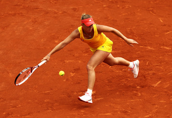 PARIS, FRANCE - MAY 31:  Caroline Wozniacki of Denmark plays a forehand in her women's singles second round match against Jarmila Gajdosova of Australia during day 5 of the French Open at Roland Garros on May 31, 2012 in Paris, France.  (Photo by Matthew