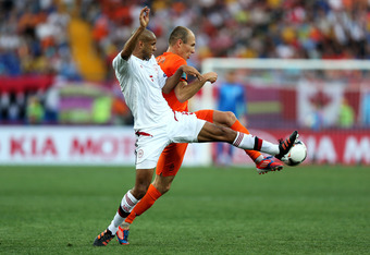 KHARKOV, UKRAINE - JUNE 09:  Simon Poulsen of Denmark and Arjen Robben of Netherlands compete for the ball during the UEFA EURO 2012 group B match between Netherlands and Denmark at Metalist Stadium on June 9, 2012 in Kharkov, Ukraine.  (Photo by Ian Walt